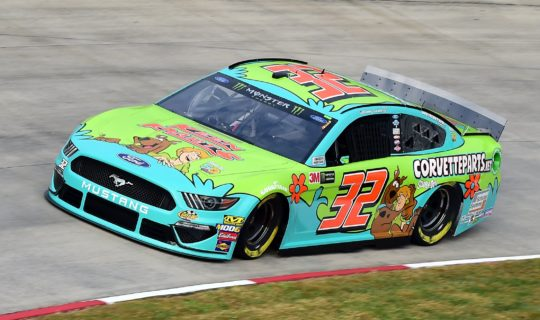 On track photo of the Scooby-Doo paint scheme for NASCAR driver Corey LaJoie